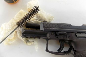 HK VP9 with slide locked back and cleaning supplies