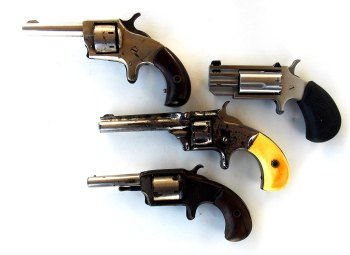Four small revolvers