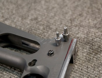 pins acting as a jig to insert the ear and hammer on a 1911 pistol