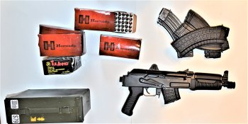 Arsenal SAM7K-44 pistol, Hornady ammunition boxes, magazines, and green ammo can