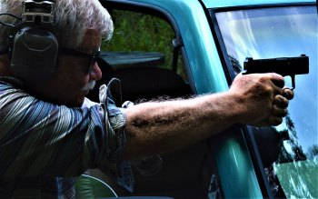 Firing the Beretta APX Carry pistol over the windshield of a pickup truck