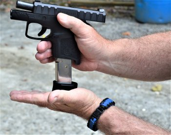 loading a magazine into a pistol