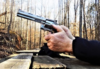 Two hands fholding the new Colt Python through recoil