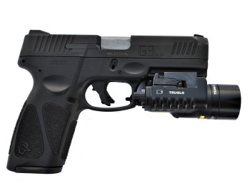 Taurus G3 9mm pistol, black, with TruGlo tactical light attached to the dust cover