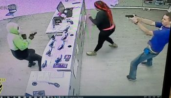 Employee with gun shooting at an armed robber over the counter