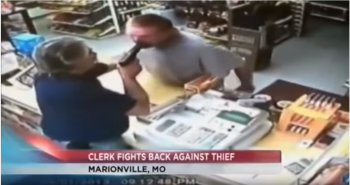 one of our armed good guys shoving a gun into a would-be robber's mouth
