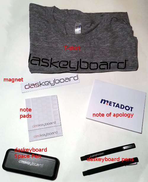 T-shirt, magnet, note pads, note of apology, daskeyboard Space Pen, daskeyboard pens