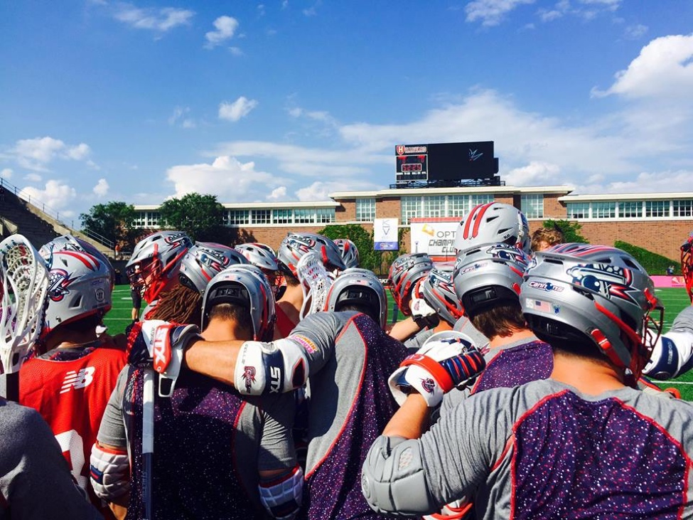 The Boston Cannons huddle together during warmups.