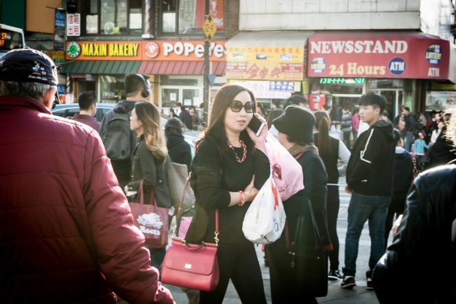 Woman talking on cell phone in Flushing Queens street photography series
