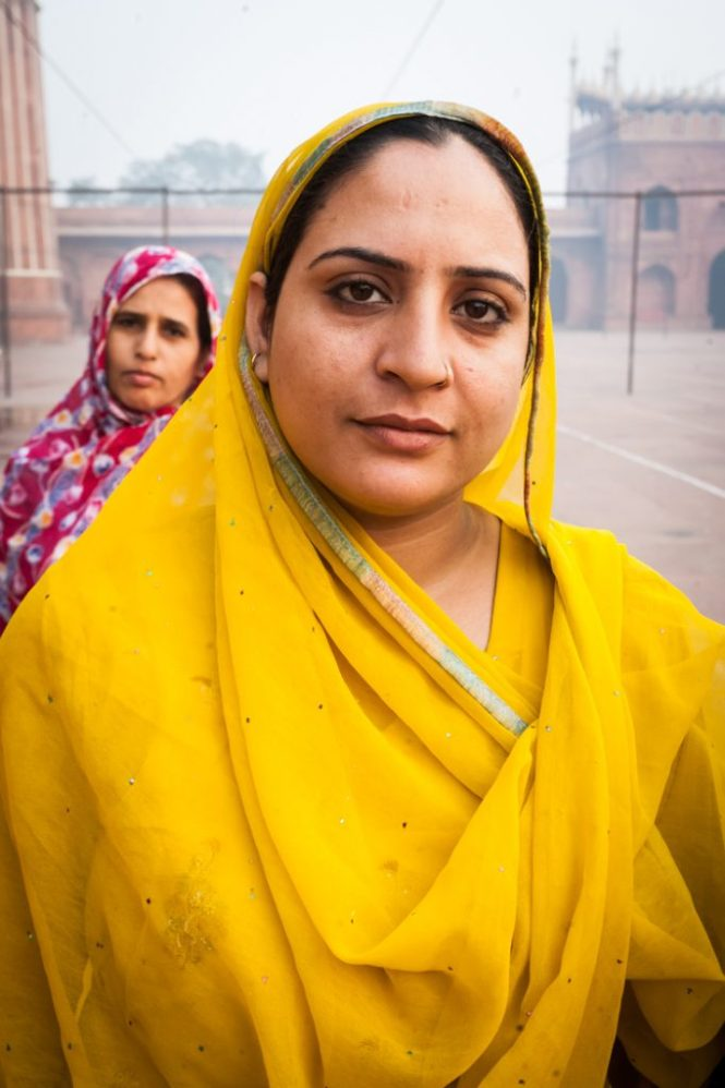 Woman in a yellow sari in Delhi, India