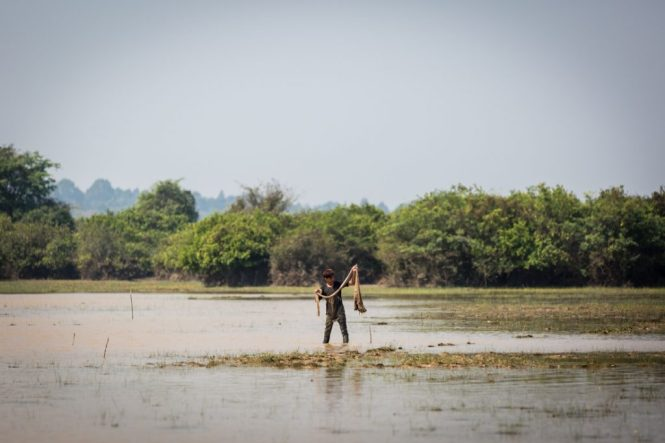 Fisherman for an Angkor Wat temple guide