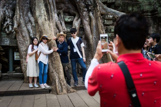 Tourists at Ta Prohm for an Angkor Wat temple guide