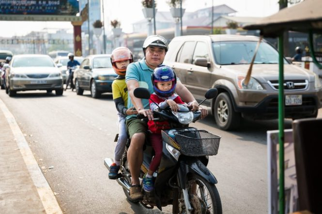 Family on a motor bike for an article on Siem Reap travel tips
