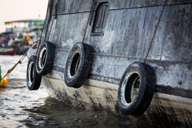 Tires on the side of a boat at the Cai Rang Floating Markets