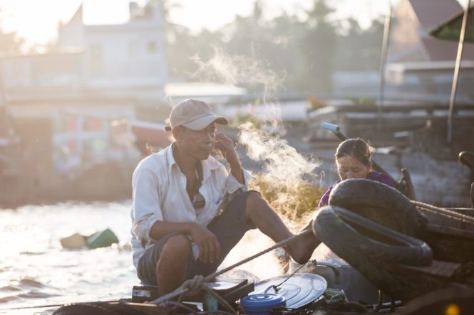 Man smoking at the Cai Rang Floating Markets