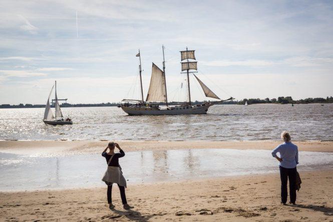 People watching sailing ship in Blankenese, Germany