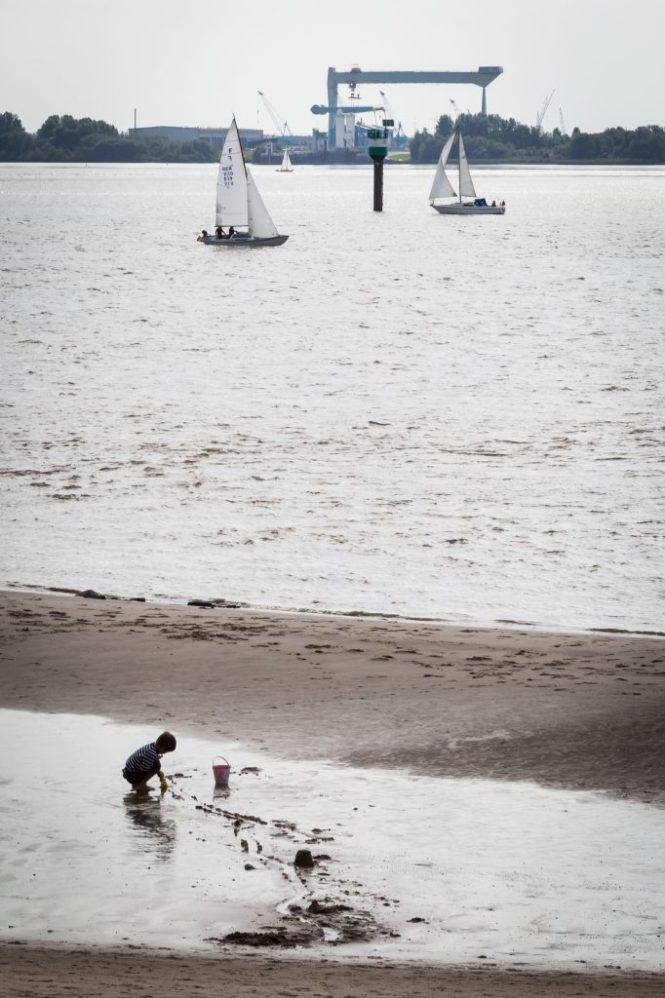 Kid on shore in Blankenese, Germany