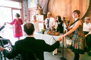Blessing the challah, by NYC bat mitzvah photographer, Kelly Williams