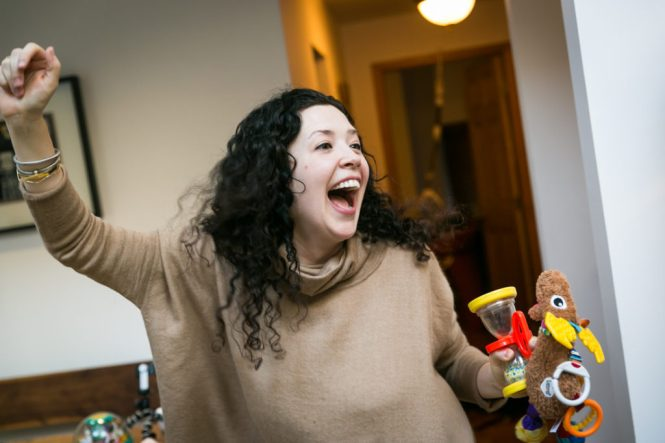 Mother entertaining child for an article on indoor baby portrait tips