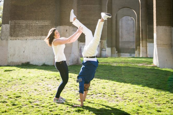 Couple doing gymnastics for an article on best engagement photos