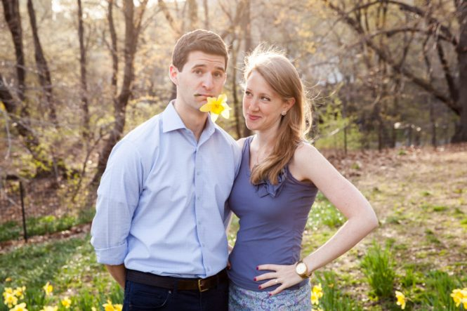 Couple posed with a daffodil for an article on best engagement photos