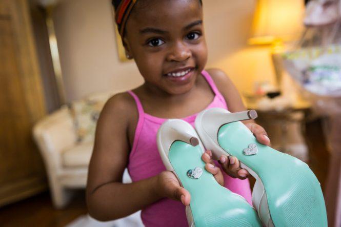 Little girl with high heels at a Glen Terrace wedding