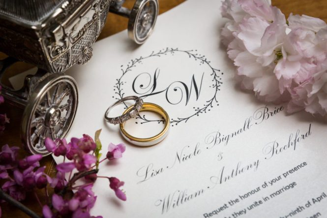 Wedding rings and invitations at a Glen Terrace wedding