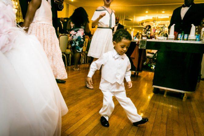 Little boy dancing at a Glen Terrace wedding