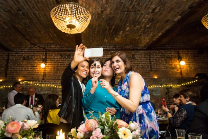 Guests taking a selfie at a Wythe Hotel wedding