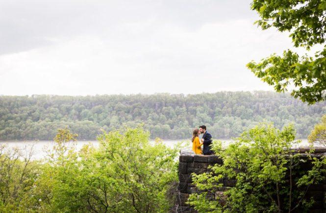 Kissing couple at a Fort Tryon Park engagement portrait