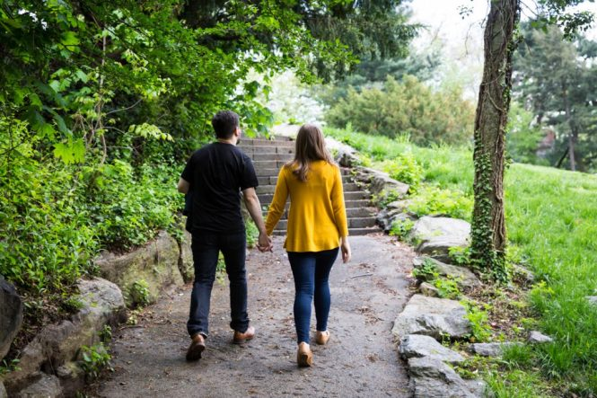 Couple walking hand-in-hand at a Fort Tryon Park engagement portrait