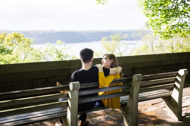 Couple on bench at a Fort Tryon Park engagement portrait