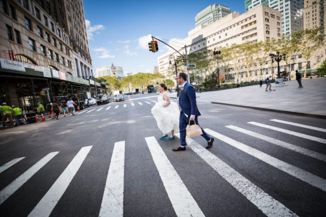 Bride and groom walking to a Brooklyn Historical Society wedding