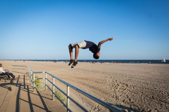 Kid doing a back flip at Coney Island