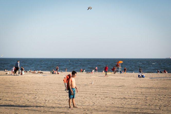 Kid on the beach at Coney Island