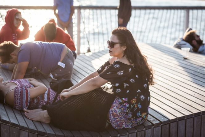 Woman in sunglasses on the Coney Island pier