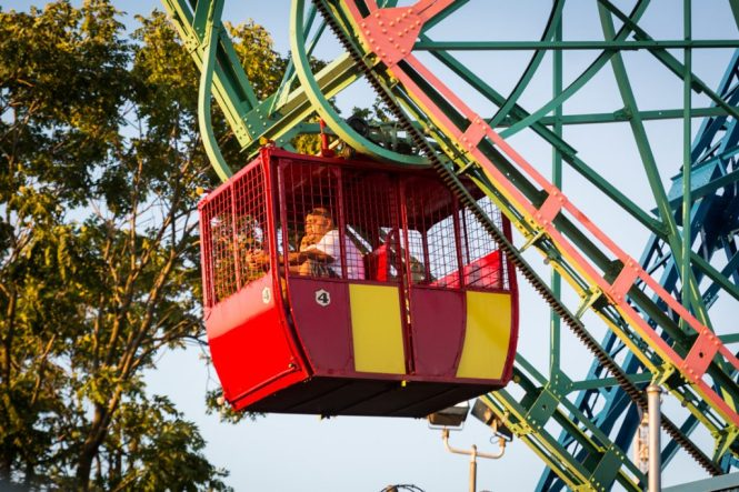 Large man riding the Coney Island Wonder Wheel