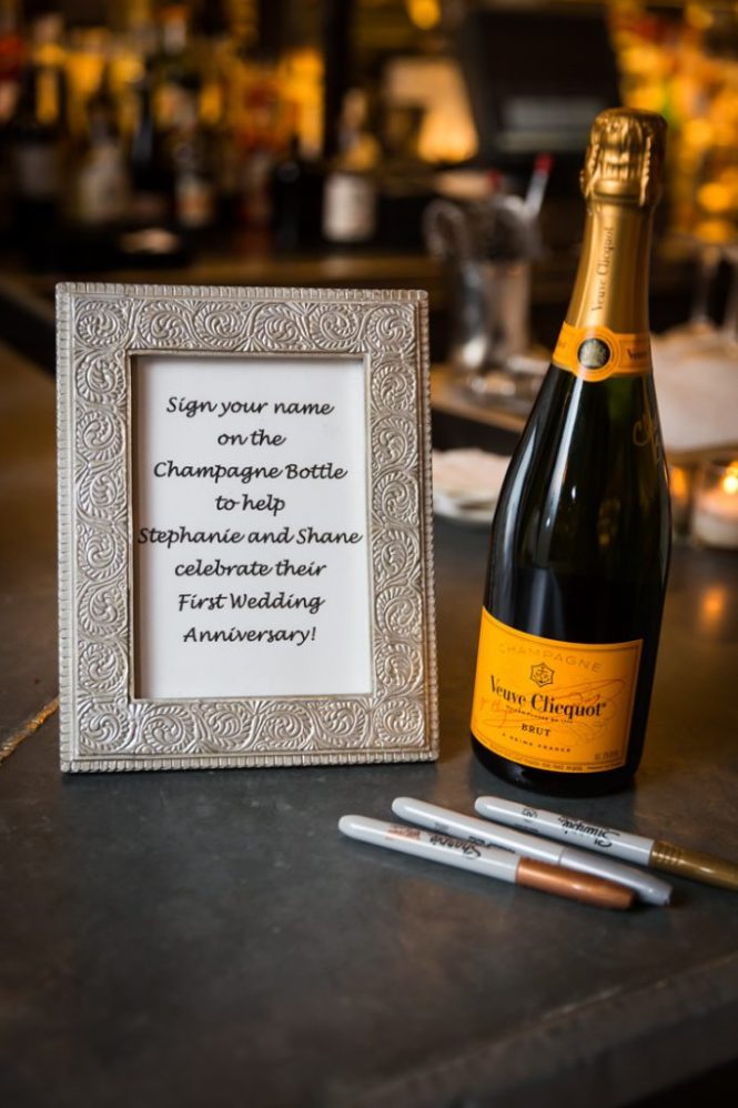 Champagne bottle at a rehearsal dinner for an article on details your wedding photographer needs to know