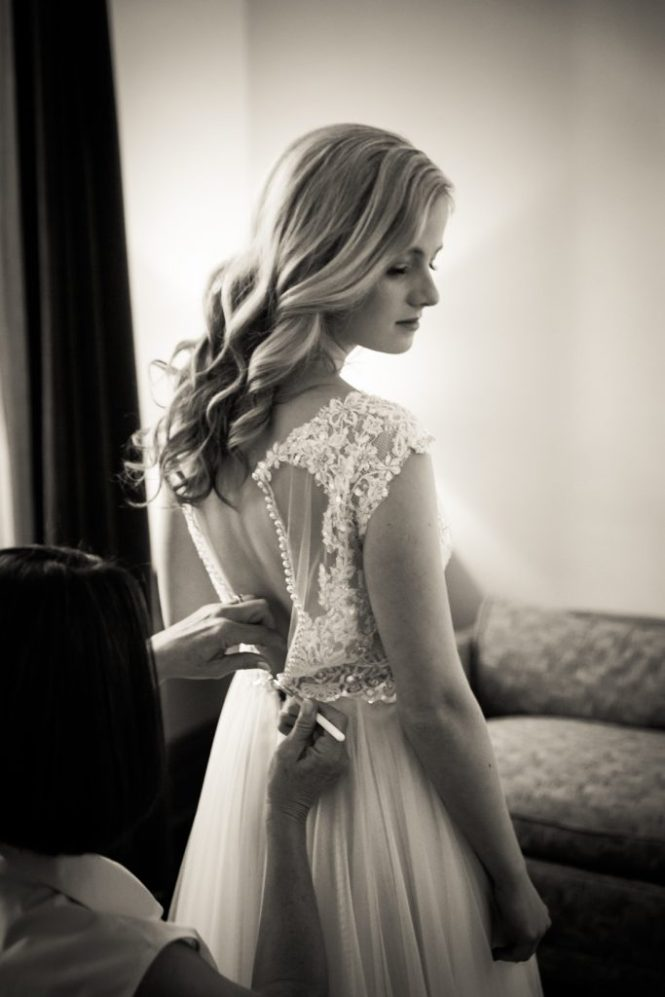 Bride getting into dress before a Gallow Green wedding