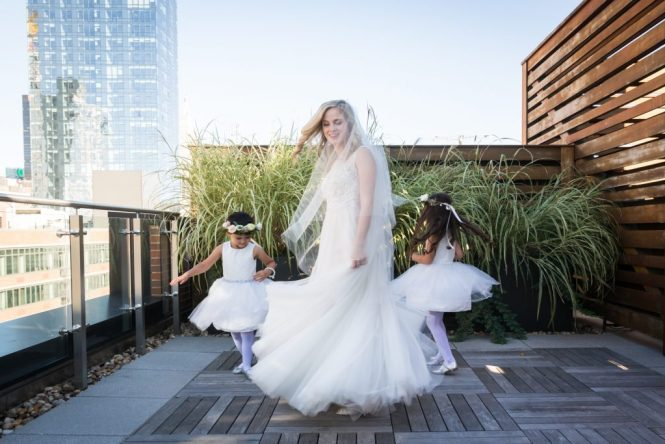Spinning bride and flower girls at a Gallow Green wedding