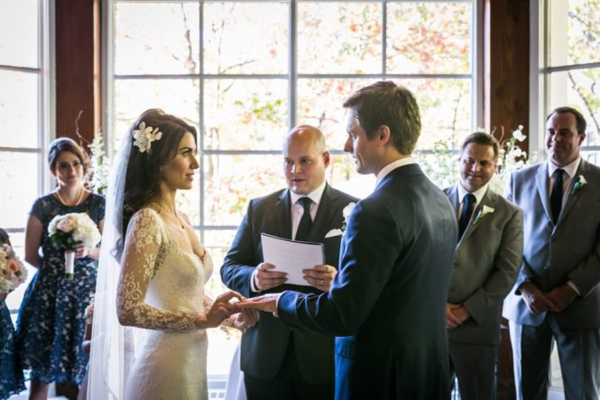 Bride And Groom Saying Vows For An Article On Wedding Officiant Tips