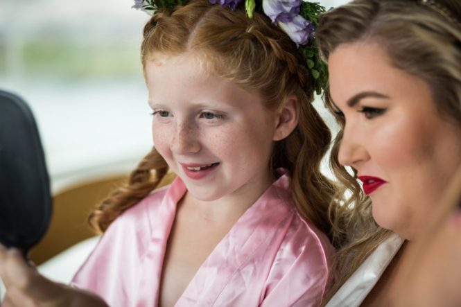 Bride and flower girl getting ready for a 26 Bridge wedding