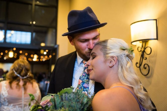 Guests embracing at a 26 Bridge wedding