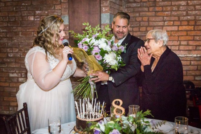 Giving flowers to grandmother at a 26 Bridge wedding