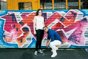 Engagement portrait at the Welling Court Mural Project