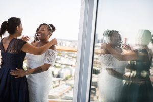 Bride and guest laughing for an article on elopement tips