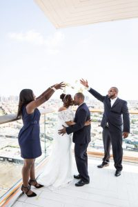 Sprinkling the bride and groom with rose petals for an article on elopement tips