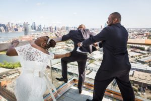 Grooml trying to jump over the ledge for an article on elopement tips