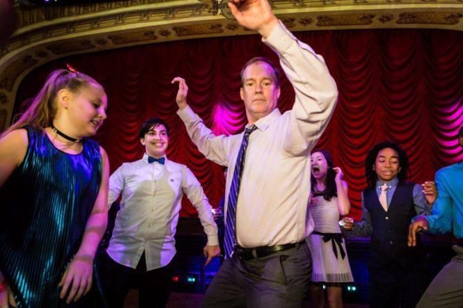Guests dancing at a bat mitzvah for an article on 'How to Find a Venue'