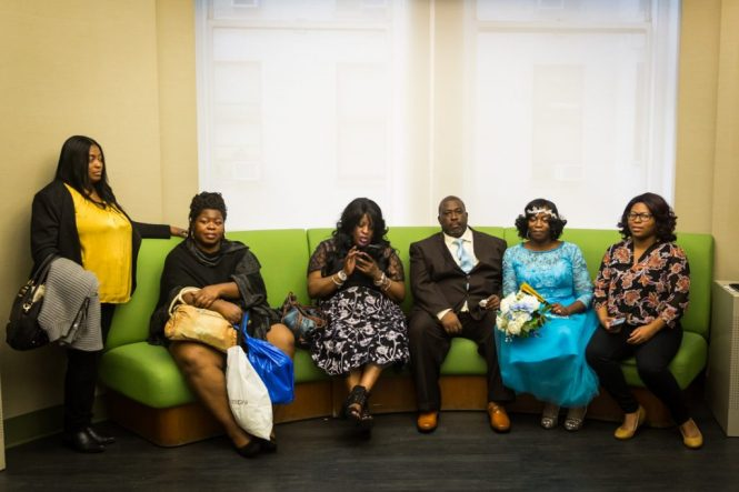 Couple and family waiting for an article on How to Get Married at City Hall in Any NYC Borough